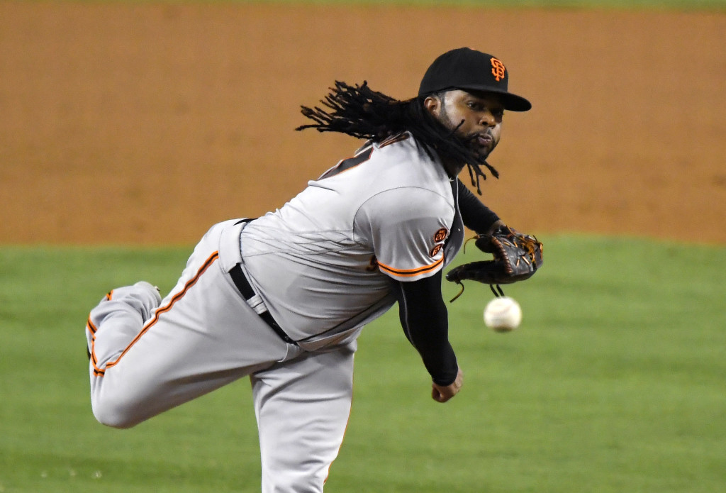 Giants top Dodgers, 2-0, despite injuries to Cueto, Crawford