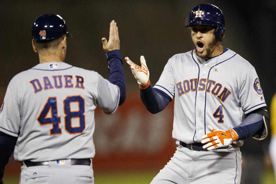 Springer delivers, Astros hold off Athletics in 10 innings