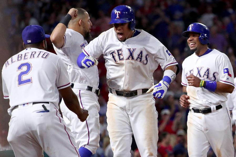 Gomez homers in 8th, Rangers rally again to beat Brewers 8-5