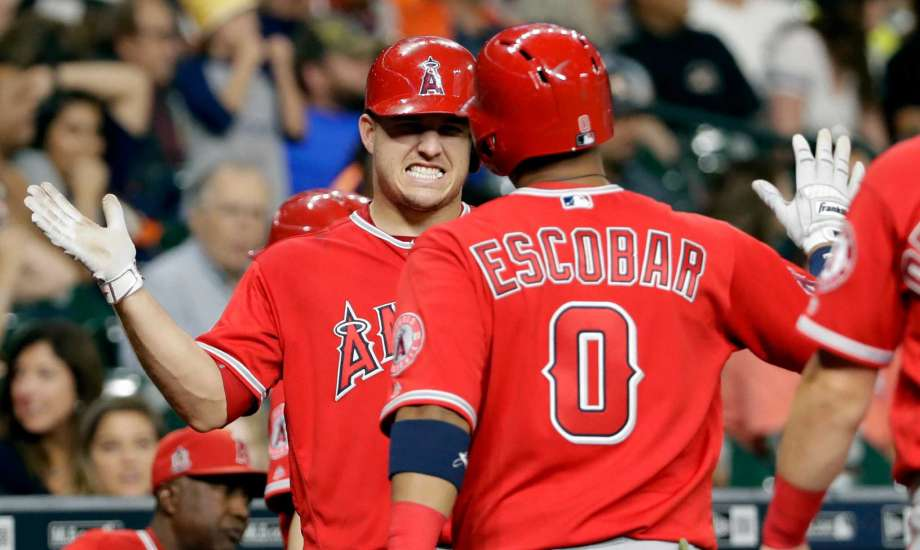 Angels use 6-run ninth to rally for 10-6 win over Astros