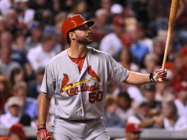 Wainwright drives in 4 as Cardinals beat Rockies 10-5