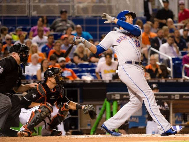 Mets help playoff chances by beating grieving Marlins 5-2
