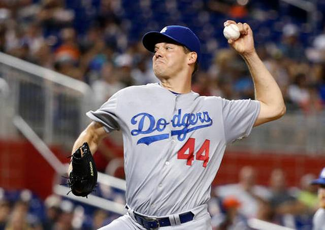 Hill pulled after 7 perfect innings; Dodgers top Marlins 5-0