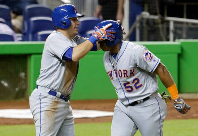 Mets help playoff chances by beating mourning Marlins 12-1