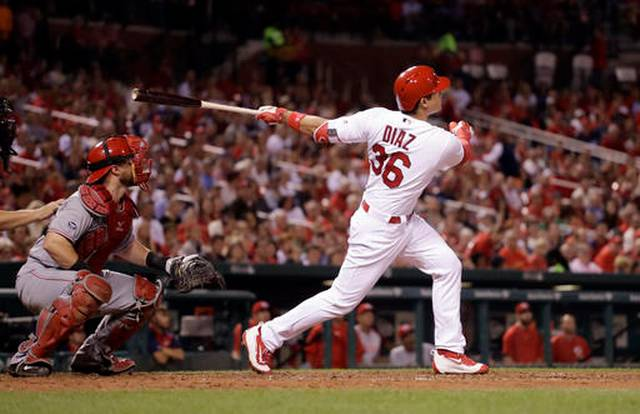 Diaz, with heavy heart, powers Cardinals past Reds 12-5