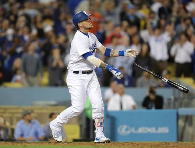 Grandal's grand slam rallies Dodgers past Rockies 7-4