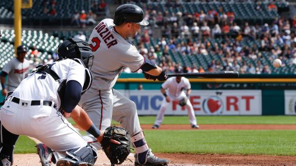 Dozier's two-run single helps Twins beat Tigers, 5-1
