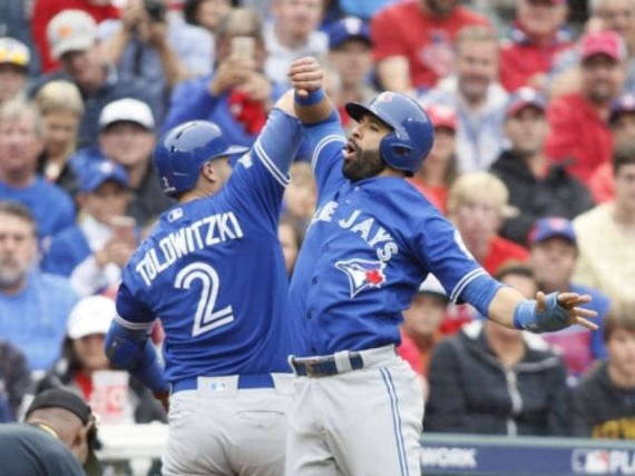 Blue Jays hit 4 home runs, beat Texas for 2-0 lead in ALDS