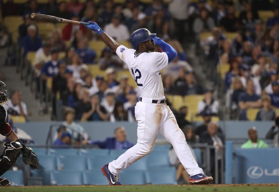 Puig hits 3-run HR to help Dodgers beat D-backs 8-4