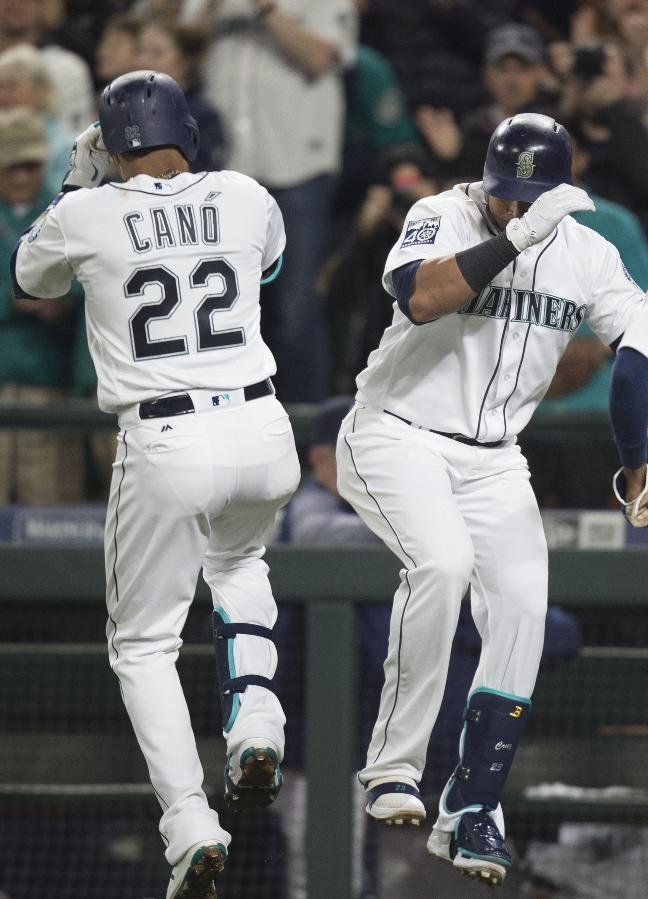 Cano, Cruz power Mariners past Marlins in Ichiro return