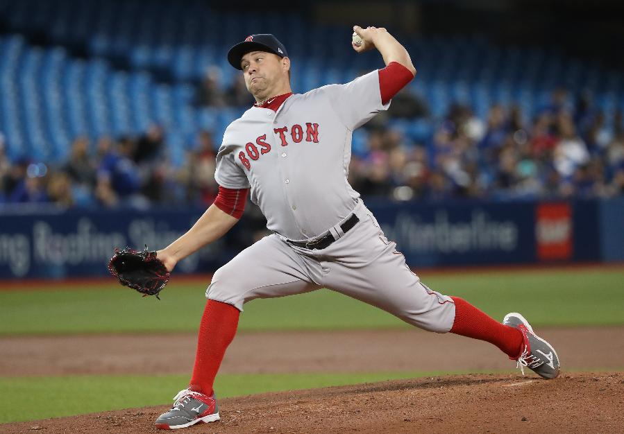 Johnson earns first win as Red Sox edge Blue Jays 8-7