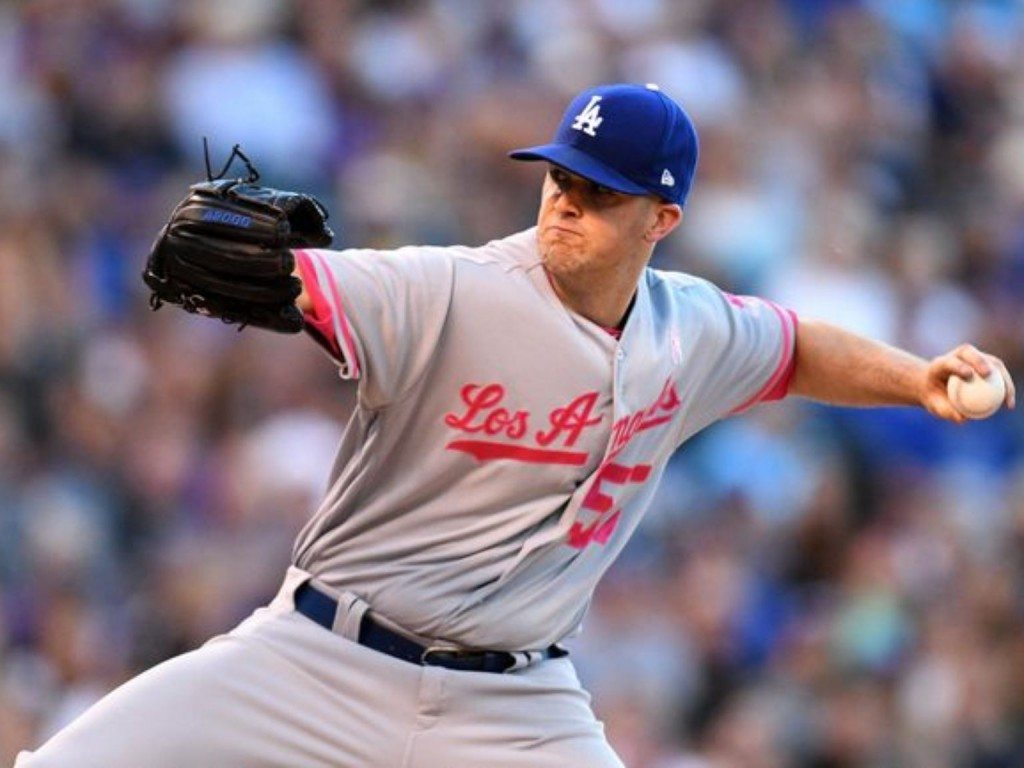 Wood strikes out 10, Dodgers blank Rockies 4-0