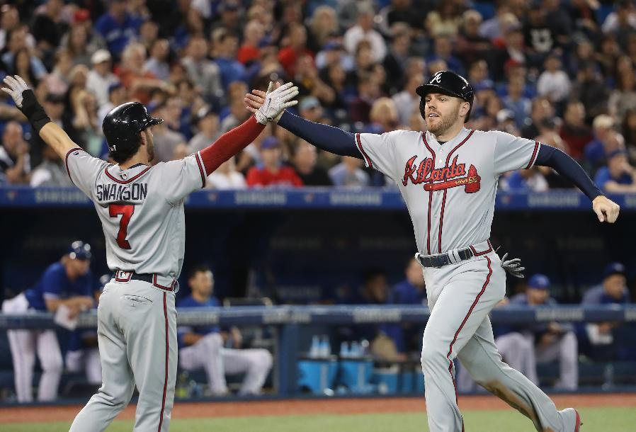 Swanson hits tiebreaking HR, Braves beat Blue Jays 9-5