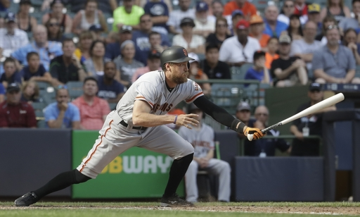 Giants get 4 in 10th, hold on for wild 9-5 win over Brewers