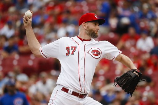 Feldman holds down depleted Cubs for Reds' 5-0 victory