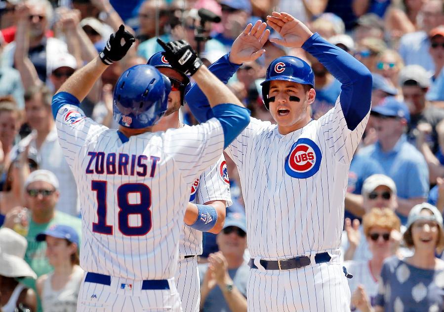 Cubs hit four homers, end Rockies 7 game win streak