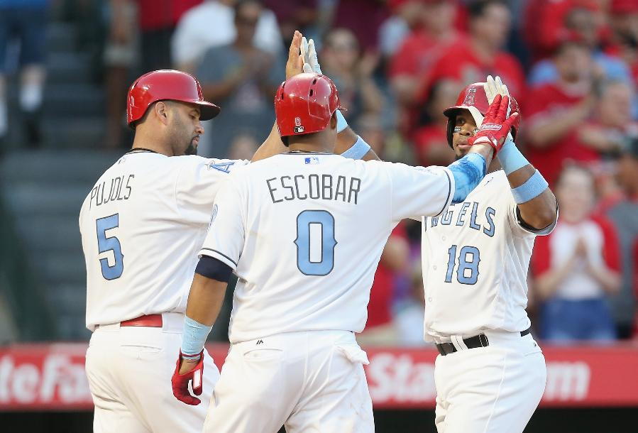 Angels get 3 homers to snap Royals' six-game win streak