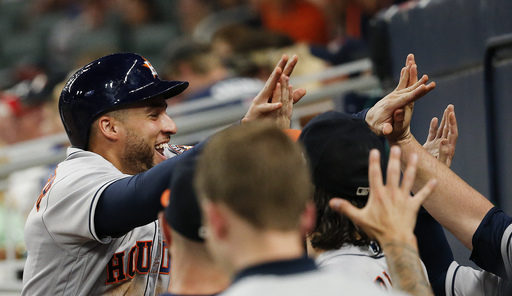 Springer, Astros keep streaking in win over Braves