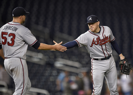 Freeman, Braves douse Nationals 5-2 following 3-hour delay