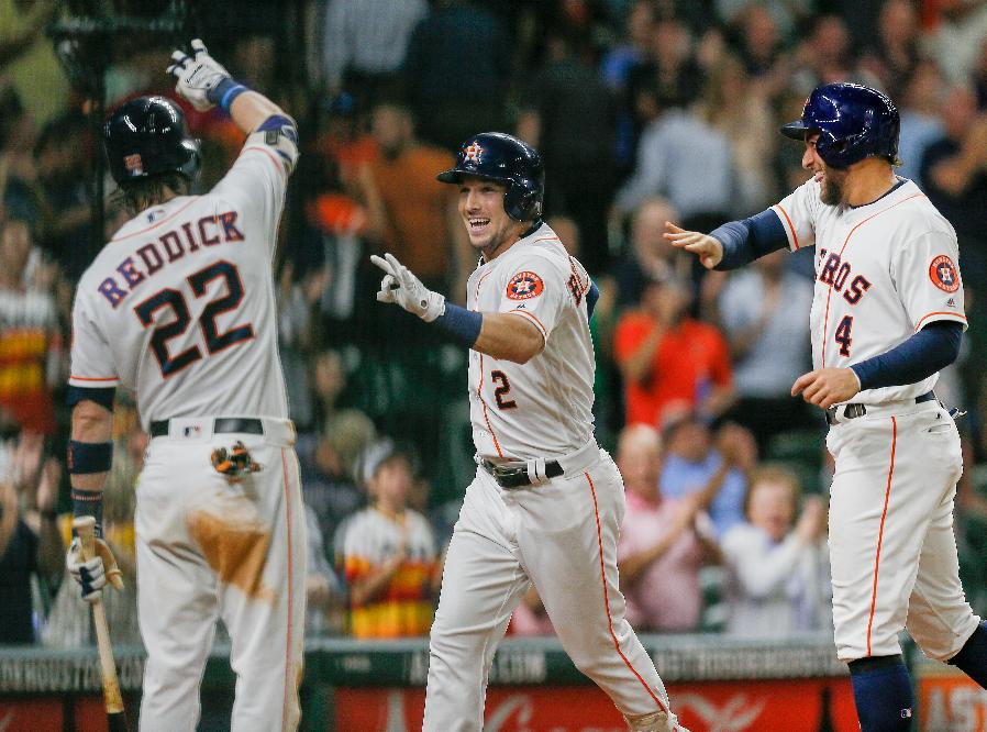 Astros hit 3 homers to end skid vs Nationals
