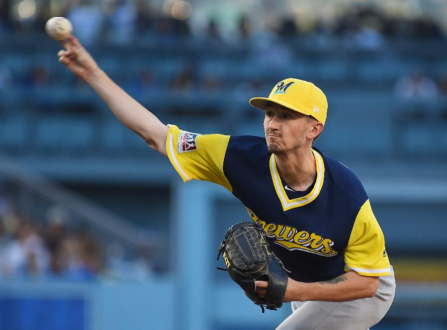Davies dominates Dodgers for 7 innings; Brewers win 3-0
