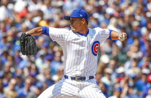 Happ's bat, Quintana's arm lead Cubs over Blue Jays 4-3