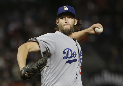 Dodgers battle past Giants to snap 11-game slide, clinch playoff spot