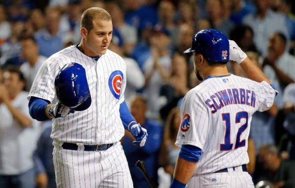 Rizzo, Heyward lead surging Cubs to sweep of Mets, 14-6
