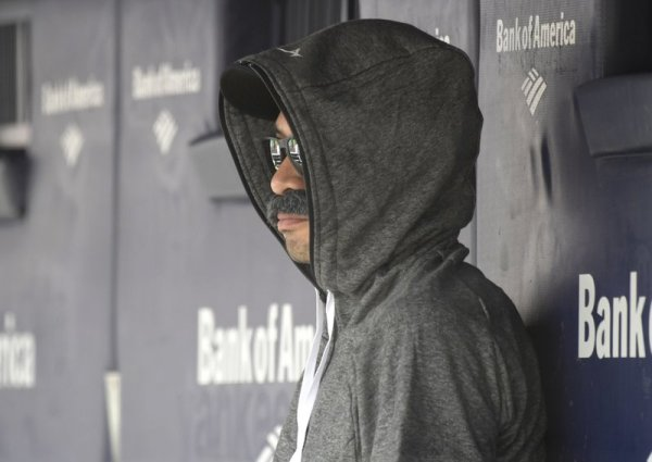 Ichiro Suzuki sits on Mariners bench in fake mustache disguise